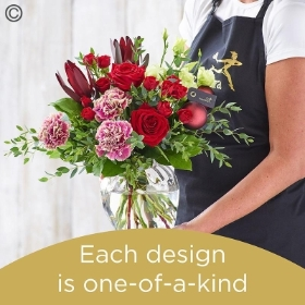 Christmas hand tied bouquet and vase made with the finest flowers